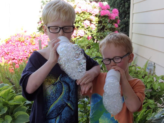 "Evander and Gideon Mann compete for making the biggest bubble bunching using ""wands"" they created out of water bottles and socks."