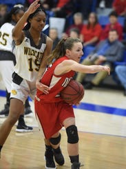 Norfork's Ivy McGowan is defended by Watson Chapel's