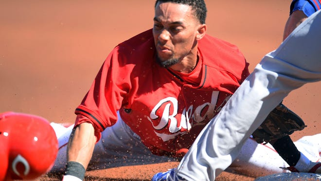 Billy Hamilton steals third base during a spring training game.