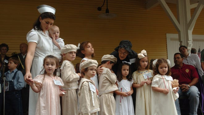 At the grand opening of the museum, actors portray orphans and a nurse who accompanied the children on the Orphan Train. Two nuns and two nurses rode with children from the New York Foundling Home to their destinations.