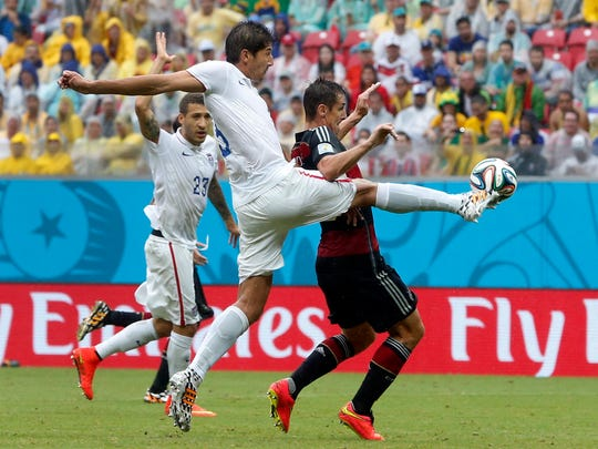 United States' Omar Gonzalez, left, and Germany's Miroslav Klose challenge for the ball during the group G World Cup soccer match between the USA and Germany on June 26 at the Arena Pernambuco in Recife, Brazil.