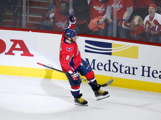 Washington Capitals left wing Alex Ovechkin (8), from Russia, celebrates the only goal of the shootout in an NHL hockey game against the Boston Bruins, Thursday, Dec. 28, 2017, in Washington. The Capitals won 4-3. (AP Photo/Alex Brandon)