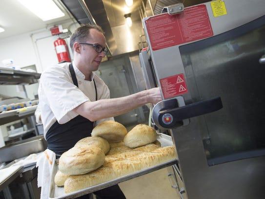 John Gutierrez prepares the kitchen for dinner service