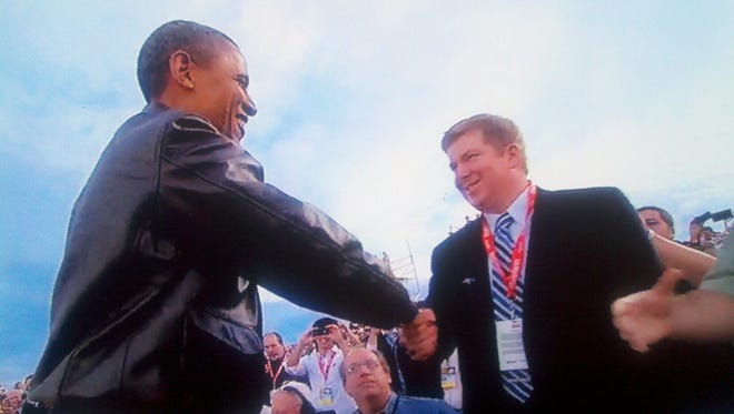 President Barack Obama shakes hands with MSU beat reporter Joe Rexrode aboard the USS Carl Vinson in 2011.