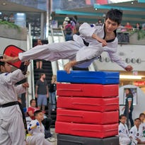 Jed Caluag shows the form that claimed the gold medal for the fourth year in a row in the men's seniors division during the Master Noly's 5th Annual Flying Side Kick tournament.