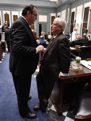 Rep. Earl Jaques Jr., D-Glasgow, left, is seen talking with now-retired Rep. Joseph Miro during last year's legislative session. Jaques who heads the House Education Committee and now has a seat on the budget-writing Joint Finance Committee, says he would like to see more funding for some education programs than was proposed by Gov. John Carney.
