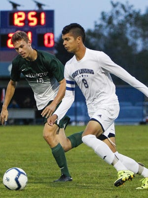East Lansing's Quinton Hay moves the ball against Williamston's Caleb Schuiteman to the ball last season at the East Lansing Soccer Complex.