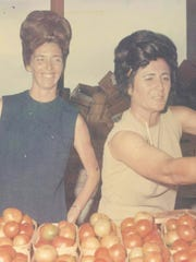 Doris Berry, right, and her business partner, Nell Cody, working at their farmers market stand in the 1960s.