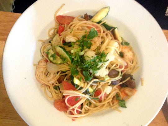 Vegan Shrimp Pasta with wheat noodles, vegetables and imitation shrimp is one of many dishes to make the transition from the shuttered Loving Hut to the new Vegan Kitchen in Neapolitan Way.