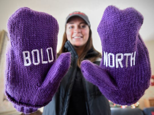 Abby Spanier wears mittens given to volunteers for the upcoming Super Bowl in Minneapolis during an interview Saturday, Dec. 9, in St. Cloud.