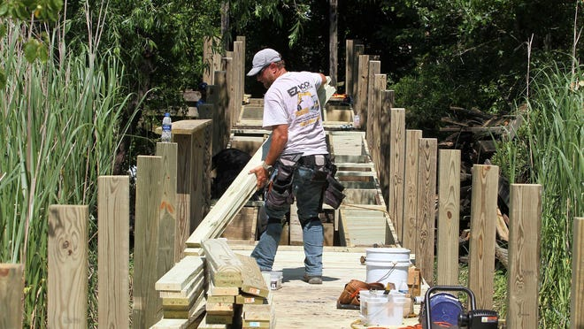 Carpenters with EZ Dock Marine Construction work to rebuild the nature trail boardwalk at Lawson Creek Park in New Bern. Construction is in progress for the scenic walkway after the original structure was damaged by exposure and Hurricane Florence in 2018.