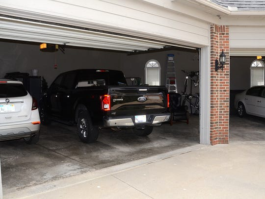 A four-car garage in a home on Lighthouse Pointe is