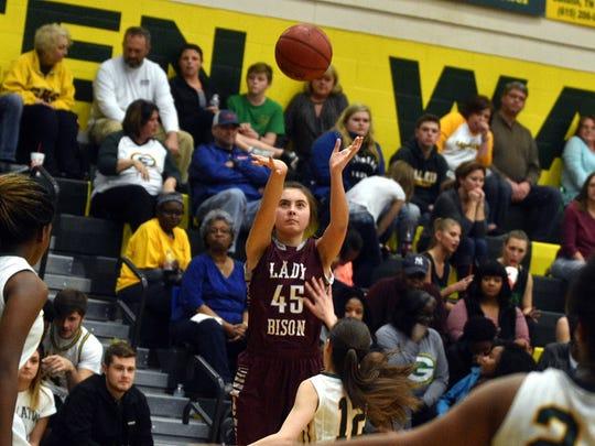 Station Camp's Olivia Delk shoots a 3-pointer over