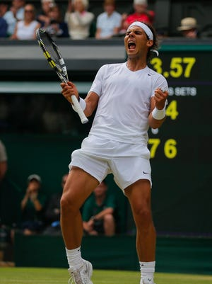 Rafael Nadal of Spain celebrates as he defeated Lukas Rosol of Czech Republic in their men's singles match on Centre Court at the All England Lawn Tennis Championships in Wimbledon, London, Thursday.