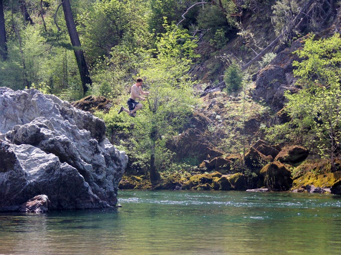 Zach Urness jumps off a rock into the deep pools of Southwest Oregon's Illinois River in the Store Gulch Campground area of the canyon famous for swimming holes and sandy beaches.