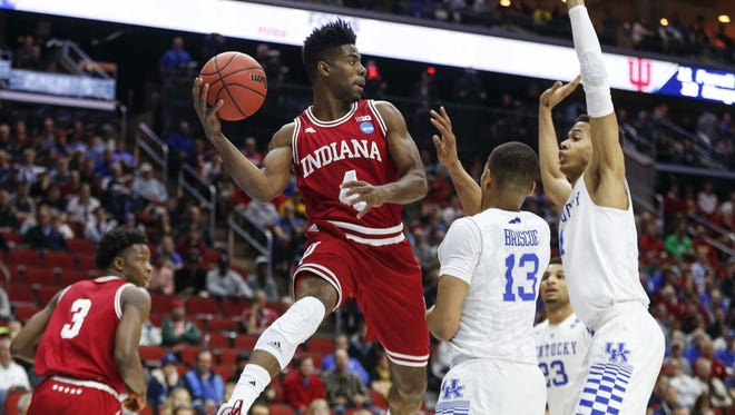 Indiana sophomore Robert Johnson saves the ball from going out of bounds against Kentucky on Saturday, March 19, at Wells Fargo Arena in Des Moines.