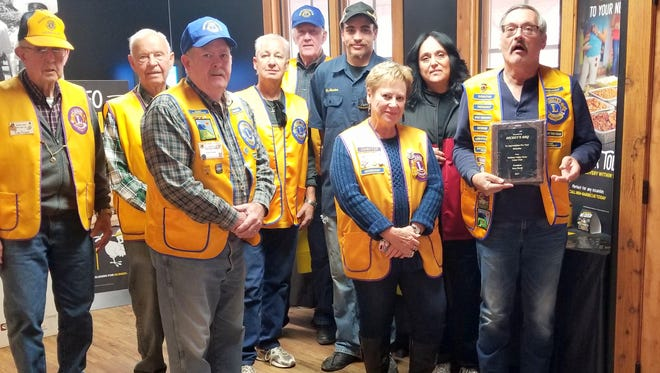 Members of the Ruidoso Valley Noon Lions presented an award to Dickey's BBQ in Ruidoso Downs for a generous donation of food for Aspenfest parade day. Those pictured are President Sam Pirelli, far right, president, along with Secretary Jean Ballard, Treasurer Don Fowler and members Katherine Pirelli, Ward Hook, Michael Kump, Tom Payne and Jerry Leonard.