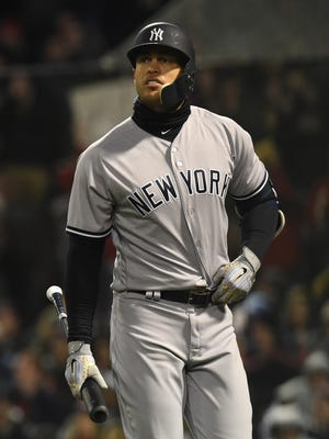Apr 10, 2018; Boston, MA, USA; New York Yankees right fielder Giancarlo Stanton (27) walks back to the dugout after striking out for the second time in as many at bats during the third inning against the Boston Red Sox at Fenway Park.