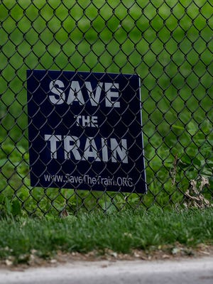 """A sign that reads, """"Save the Train"""" is placed inside the Indiana Transportation Museum in Forest Park in Noblesville, Ind., on Wednesday, June 7, 2017. The museum and the City of Noblesville are clashing over conditions of the train yard."""