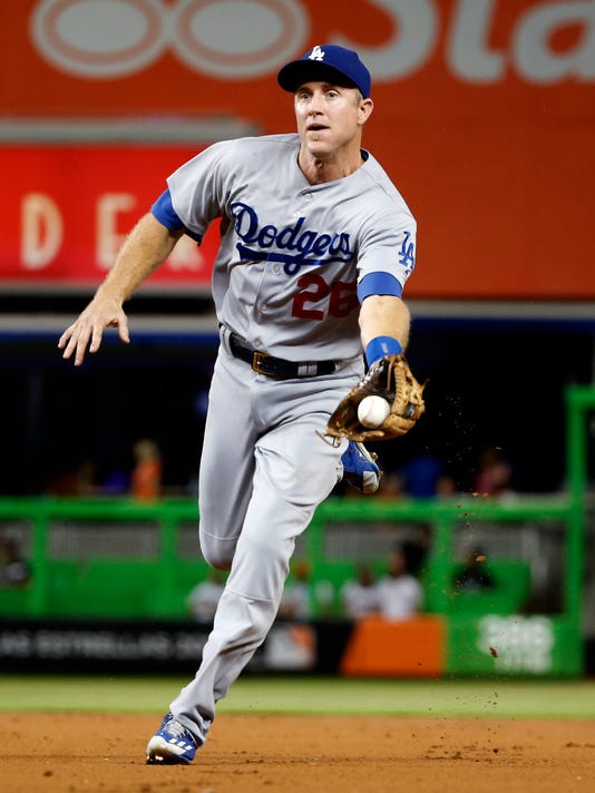 Los Angeles Dodgers second baseman Chase Utley tosses the ball to first base to get out Miami Marlins' Christian Yelich during the first inning of a baseball game, Friday, Sept. 9, 2016, in Miami. (AP Photo/Wilfredo Lee)