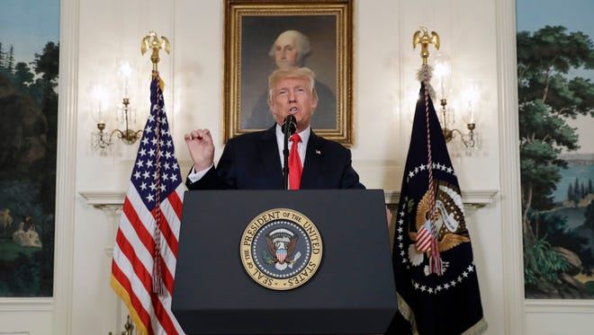 President Trump speaks in the Diplomatic Reception Room of the White House in Washington on Monday.