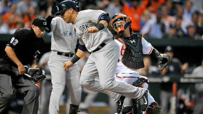 Yankees designated hitter Carlos Beltran steals home in the second inning against the Baltimore Orioles on Monday.