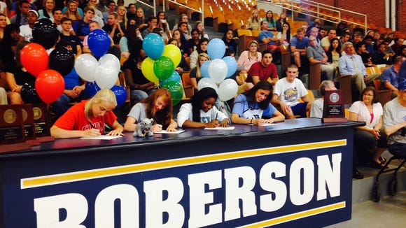 Roberson seniors, from left to right, Caitlin Cannon, Casey Greenwalt, Arianna Whiteside and Lauren Moody have signed with college track programs.