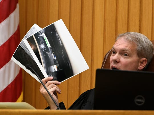 Knox County Criminal Court Judge Steven Sword considers photographs in court Thursday, Sep. 21, 2017 which Tyler Enix's defense attorney wants excused during his trial starting Monday.