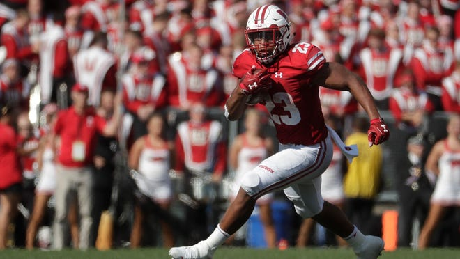 FILE - In this Sept. 15, 2018, file photo, Wisconsin's Jonathan Taylor runs during the first half of an NCAA college football game against BYU, in Madison, Wis. The 18th-ranked Badgers (2-1) haven't been the dominant team everyone expected them to be and, following their home loss to BYU, are looking to reset the season in their Big Ten opener against Iowa. The key will be how Wisconsin RB Jonathan Taylor fares. (AP Photo/Morry Gash, File)
