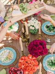 To keep spring and summer gatherings easygoing and enjoyable, Los Angeles designer Brian Patrick Flynn suggests a casual outdoor table setting in which guests can help themselves and pass dishes and platters around the table family-style.