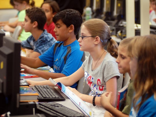 Fifth graders in the technology Lab at Suntree Elementary