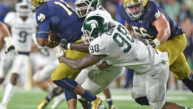 Demetrius Cooper (98) started 11 games for for the Spartans last season.