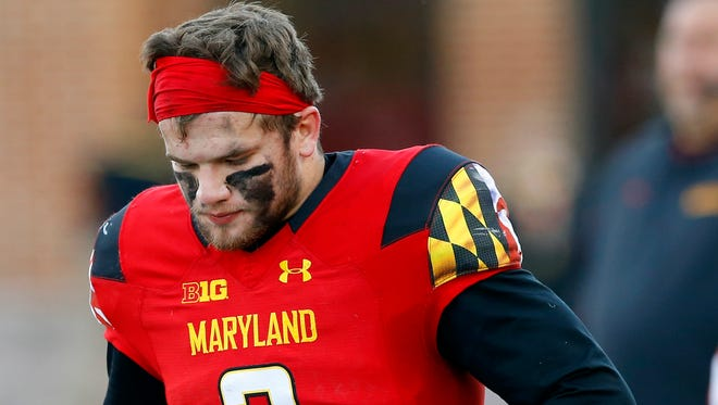 Maryland quarterback Shane Cockerille, left, walks on the sideline in the second half of an NCAA college football game against Indiana, Saturday, Nov. 21, 2015, in College Park, Md. Indiana won 47-28. (AP Photo/Patrick Semansky)