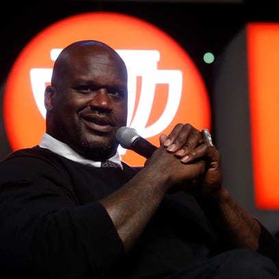 Shaquille O'Neal answers questions on stage Saturday,