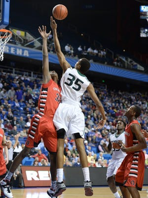 Trinity junior Raymond Spalding, soaring for a rebound in Wednesday's victory over Owensboro, already has scholarship offers from nine major colleges.