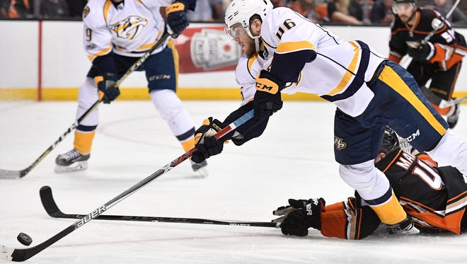 Nashville Predators left wing Pontus Aberg (46) dives for the puck past Anaheim Ducks defenseman Josh Manson (42) during the third period of game 5 of the Western Conference finals at the Honda Center in Anaheim, Calif., Saturday, May 20, 2017.