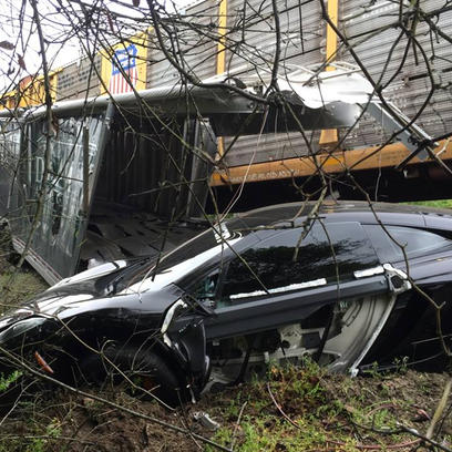 McLaren MP4-12C damaged in collision with train in