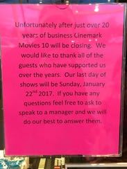 A sign at Movies 10 informs guests of its last day.