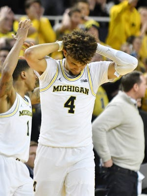 Michigan forward Isaiah Livers (4) reacts after a foul is called on Michigan with score tied and 4 seconds to go.