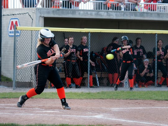 Gibsonburg's Ashley Hasselbach takes a cut Thursday against Carey in a Division IV regional semifinal matchup at Marathon Diamonds in Findlay.