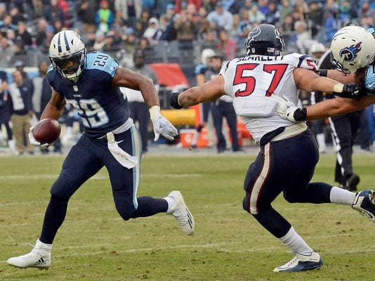 Tennessee Titans running back DeMarco Murray (29) tries to get past Houston Texans strong safety Quintin Demps (27) in the second half of an NFL football game Sunday, Jan. 1, 2017, in Nashville, Tenn. Murray finished his first season with the Titans leading the AFC in rushing and third overall in the NFL. The veteran running back said Sunday after the Titans defeated Houston 24-17 that he finished the season playing with a torn plantar plate in his right foot. (AP Photo/Mark Zaleski)