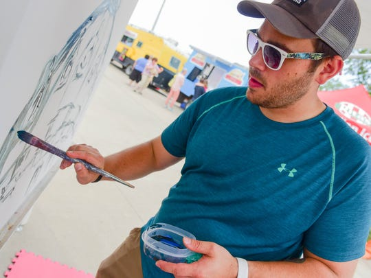 Artist Ben Schuh works on a project on Sunday, July