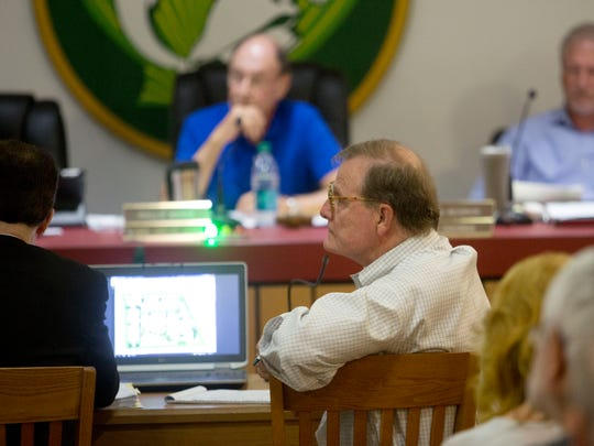 Marty Harrity, one of the owners of Doc Ford's Rum Bar and Grilleon Sanibel Island listens to public input during the Sanibel Planning Council meeting on Tuesday. They approved the location change of the restaurant.