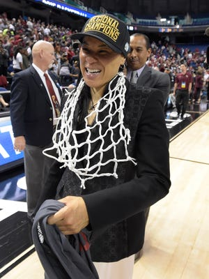 South Carolina head coach Dawn Staley takes a victory lap after her team defeated Florida State 80-74 to win their NCAA Women's Regional Tournament Sunday, March 29, 2015 at the Greensboro Coliseum in Greensboro, N.C.