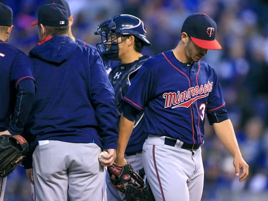 Minnesota Twins starting pitcher Tommy Milone, right, is relieved during the fifth inning of a baseball game against the Kansas City Royals at Kauffman Stadium in Kansas City, Mo., Saturday, April 9, 2016. (AP Photo/Orlin Wagner)