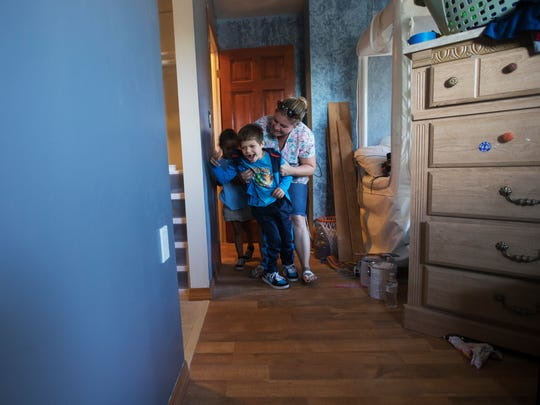 With the help of his mother, Kassandra Stafford, Victor Stafford gets a look at his room and bathroom that was renovated by volunteers from Builders Care. Victor was critically injured in a car crash that killed his mother. His aunt, Kassandra has since adopted him.