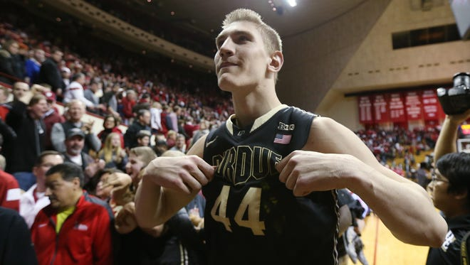 Purdue Boilermakers center Isaac Haas taunts Hoosier fans by pointing out his Purdue uniform as he leaves the floor with a 76-63 win over Indiana. Indiana hosted Purdue at Assembly Hall on Thursday, February 19, 2015.