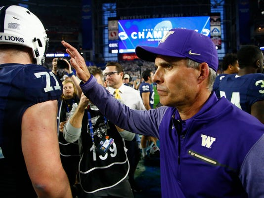 Washington head coach Chris Petersen greets Penn State players after the Fiesta Bowl NCAA college football game, Saturday, Dec. 30, 2017, in Glendale, Ariz. (AP Photo/Ross D. Franklin)