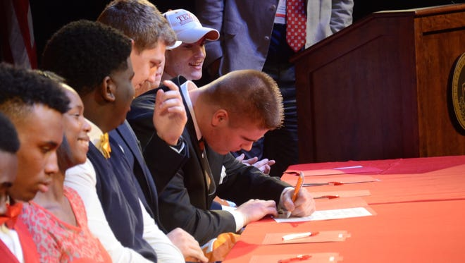 Brentwood Academy senior Ryan Johnson signs a letter of intent to play football at Tennessee.