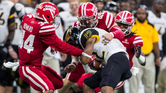 UL defenders swarm to bring down a USM ball carrier during the Cajuns' 28-21 loss to the Golden Eagles on Saturday in the New Orleans Bowl.